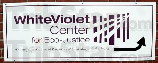 Signage: Detail of White Violet Center sign.