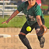 Good glove: West vigo's Allyson Walters stops a ground ball in their game with Paris Monday evening on the Vikings' diamond.