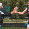 Tribune-Star/Joseph C. Garza<br /> That was all your vault: Terre Haute North pole vault coach Bob Dispennett congratulates Connor Curley on clearing the bar Saturday during the pole vault competition of the Patriot Challenge Saturday at North.