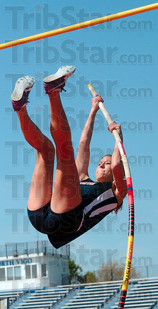 Tribune-Star/Joseph C. Garza<br /> On her way up: Terre Haute North's Rachel Welker vaults over the bar during the pole vault competition in the Patriot Challenge track & field meet Saturday at North.