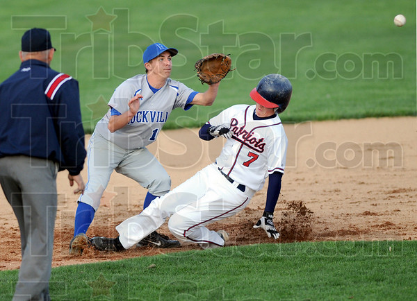 Play at second: Rockville's #13, Cody Jefferies waits for an incoming throw to second base as North's #7, Cody Gardner makes it safely to the bag during first inning action.