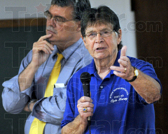 Hmmmm: State Senator Tim Skinner (L) seems deep in thought as State Representative from the 43rd District Clyde Kersey speaks to those in attendance at the candidate forum Monday evening.