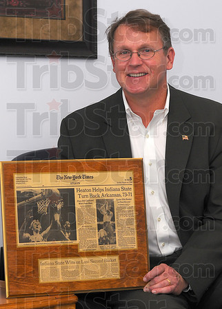 Headliner: Bob Heaton holds a tearsheet from the New York Times, dated Sunday March 18, 1979 with his name in the sports page headline.
