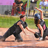 Just enough: Clay City catcher Madison Booe tags Knight baserunner Hope Torbert as she tries to score in their cross-county matchup Tuesday evening.