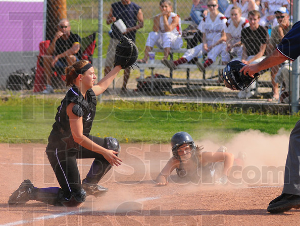 Yer out: Madison Booe shows the umpire she still has teh ball while Northview baserunner Hope Torbert looks for a safe call. Booe made the tag, no run scored.