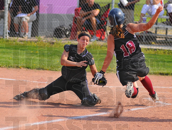 Waiting on her: Clay City catcher Madison Booe reaches towards Northview baserunner Hope Torbert for a tag out at home plate.