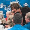 Tribune-Star/Joseph C. Garza<br /> Meet and greet: Teri Moren greets fans before the start of a press conference to introduce her as the new head coach of the Indiana State women's basketball team Tuesday at Hulman Center.