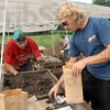 Pieces packaged: Set Burns and Mark Jaber save pieces of history for packaging at an archelogical dig site in North Terre Haute Tuesday morning.