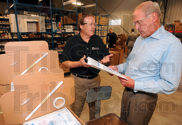 Tribune-Star/Joseph C. Garza<br /> Local product: Glas-Col President Steve Sterrett shows Dan Coats, candidate for the U.S. Senate, one of the many products his company produces during a tour for Coats Thursday.
