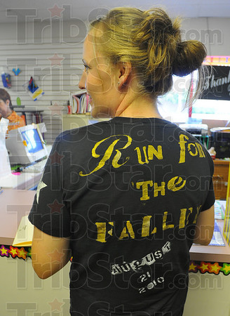 """Running: Olivia Goulding chats with Tribune-Star reporter Arthur Foulkes Thursday afternoon. She is wearing a shirt advertising the """"Run for the Fallen"""" this Saturday."""