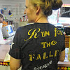 "Running: Olivia Goulding chats with Tribune-Star reporter Arthur Foulkes Thursday afternoon. She is wearing a shirt advertising the ""Run for the Fallen"" this Saturday."