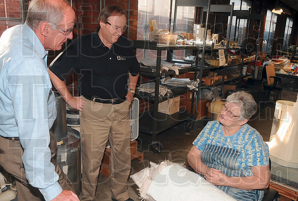Tribune-Star/Joseph C. Garza<br /> Meeting Indiana's workforce: U.S. Senate candidate Dan Coats talks with Glas-Col employee Dixie King, a mantle maker, as company president, Steve Sterrett, center, looks on during a tour of the company Thursday.