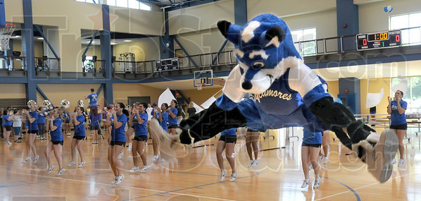 Sam: Sycamore Sam leaps into the air during an event at the Student Rec Center Thursday afternoon for faculty and staff returning for the start of the new school year.