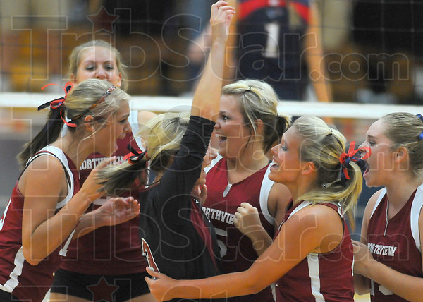 First one: Northview volleyball team members rejoice after winning the first game against Terre Haute North Thursday evening in the Patriots' gym. Pictured are: Shelbi Morris, Lizzie Emmert, Ashlen Buck, Kaylee Clark, Brianna Cook and Kalyn Bell.