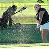 Sand shower: Northview's Hayley Miller hits a shot from the bunker during action against North and South Thursday evening at Forest Park in Brazil.