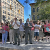 Approval: The crowd applaudes its approval of Bill Wolfe's sculpture Max Ehrmann at the Crossroads at it unveiling Thursday afternoon.