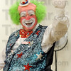 Harpo hello: Harpo the clown waves to Westminister Village residents and staff during an event Thursday afternoon.