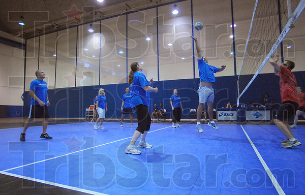 At the net: Troy Skinner of Old National Bank returns the ball to players from Bemis in the fourth annual Old National Volleyball Challenge to benefit the United Way. Seven teams participated in the double elimination tournament.