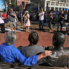 Center of attention: Photographers and videographers, professional and amateur, record images of the newly unveiled max Ehrmann sculpture with Mary Kramer and artist Bill Wolfe seated next to the work.