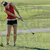 Grass: South's Caylee Walburg hits a shot during Thursday's triangular meet with North and Northview.
