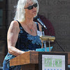 """Terre Haute: Sherry Dailey of Art Spaces reads """"Terre Haute"""" by Max Ehrmann to start the ceremony unveiling Bill Wolfe's sculpture Max Ehrmann at the Crossroads."""