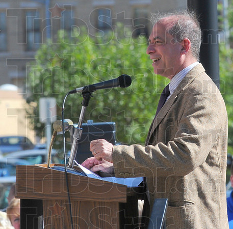 Congratulations: Lewis Ricci of the Indiana Arts Commission spoke at the dedication of the Max Ehrmann at the Crossroads sculpture Thursday afternoon.