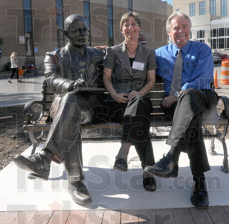 At the crossroads: Mary Kramer of Art Spaces and artist Bill Wolfe sit with the bronze of Max Ehrmann after its unveiling Thursday afternoon.
