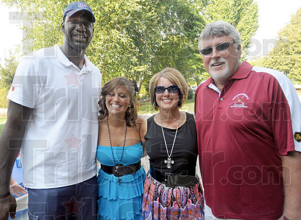 Group hug: Greg Oden poses for a photograph with Courtney, Tami and Jimmy Smith prior to the kick-off of the annual Travis Smith Memorial Golf Tournament.