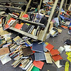 Tilt: Thousands of books lay on the floor of the second floor of the Cunningham Memorial Library on the Indiana State University campus Thursday morning.