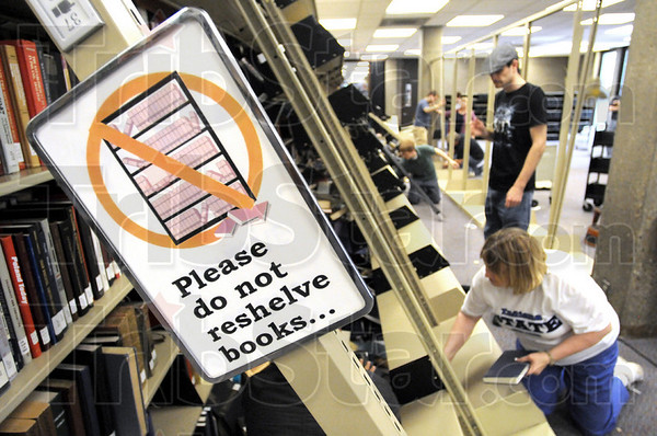 Tilt: A book shelf on the second floor of the Cunningham Memorial Library remains tilted as staff and students remove thousands of books so the shelving can be uprighted Thursday.