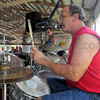 Keeping time: George Rusin plays drums while his brother Steve plays harmonica and Darrell Pruitt plays bass guitar at the Wabash Valley Musicians Hall of Fame third annual Jam and Picnic Sunday.