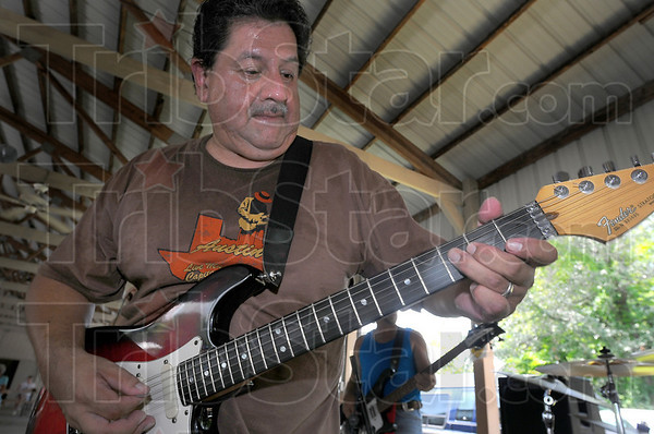 On lead: George Velez plays lead guitar during one of the many songs played Sunday afternoon at the Wabash Valley Musicians Hall of Fame Jam and Picnic.