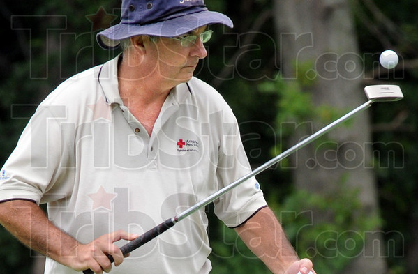 Nice catch: Dr. Michael Toney catches his golf ball on the end of his putter after sinking a putt during Men's Senior City Tournament action Sunday afternoon at Hulman Links.