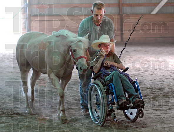 Horseman: Jessey Tumey and his father Jamie finish working with Jessey's horse Sunday afternoon on their Parke County farm.