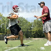 Coach: Rose-Hulman football coach Jayson Martin works with one of his players during Friday's football practice.