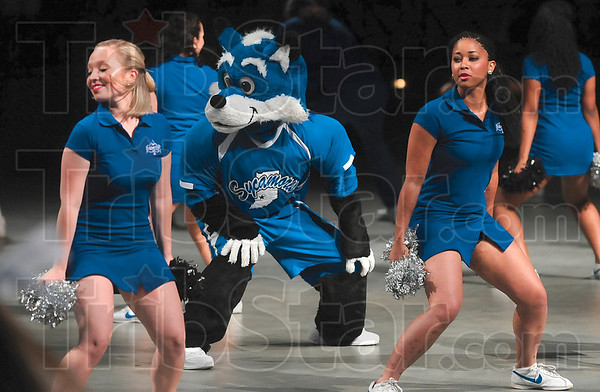 "Tribune-Star/Joseph C. Garza<br /> Sam's back: Indiana State mascot, Sycamore Sam, moves to the rhythm of ""The Wabash Cannonball"" Sunday at Hulman Center during the New Student Convocation."