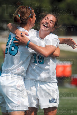 Tribune-Star/Joseph C. Garza<br /> Hug for the scorer: Indiana State's Alison Gasparovich receives a hug from teammate Laura Terry after Gasparovich scored the team's second goal against IPFW Sunday at Memorial Stadium.