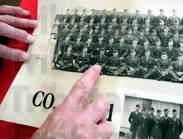 He's here: Diana Stephens points to a WWII photograph of her father James L. Sutherland during his war service.