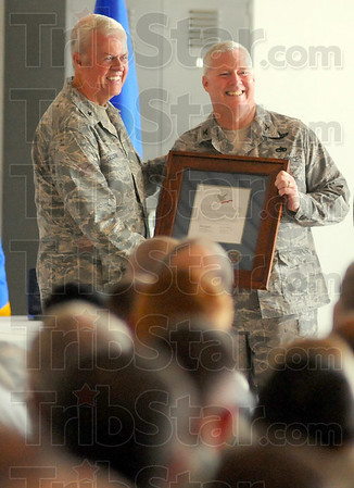 Awarded: General Stewart Goodwin presents the Hometown Heroes award to Col. Jeff Hauser, Wing Commander of the 181st Intelligence Wing.