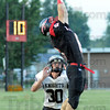Out of reach: South's #6, Kevin Bracken leaps for a high pass as Northview defender #30, Damon Hyatt attempts to defend.