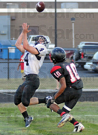 TD: Northview's #4, Zac Niehaus hauls in a pass from Trent Lancaster to score during Friday's scrimmage against South. Defending for South is #10, Dillon Bell.