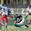 Got it: West Vigo's #8, Dylan Aff hauls in a pass between three defenders for a big gain during Friday's scrimmage against Seeger.