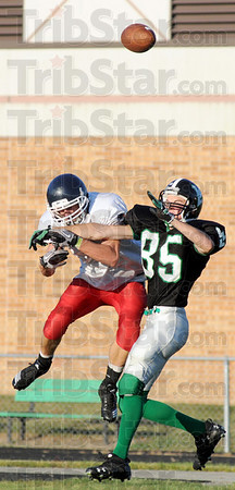 Not: West Vigo's #85, Daniel Mackey defends a Seeger receiver during Friday's scrimmage.