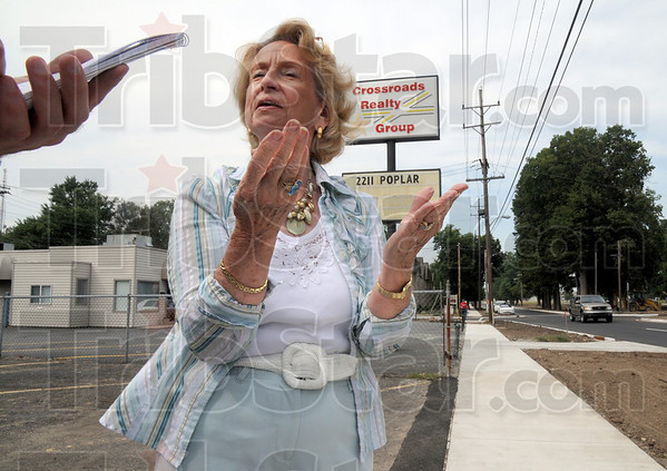 Plea: Betty Ann Mercer is pleading for help from Tribune-Star reporter Arthur Foulkes in front of her eastside business. The lack of marking signs on the new Brown Avneue project is causing traffic problems.