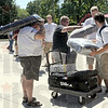 Getting loaded: Rose-Hulman students lend a hand to an arriving freshman Friday afternoon as dormatories were open for occupancy.