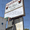 Name dropper: Roger Taylor of Signs Inc. drops the former restaurant sign to the ground after putting up the new Cackleberries sign at 7th and Poplar Friday afternoon. The business is scheduled to open in about a month.