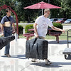 Arriving: Rose-Hulman student Jake Sheard (R) carries some of the luggage of arriving freshman Sam Oters Friday afternoon as campus prepares for the start of the school year.