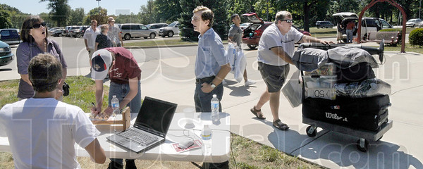 Sign in: An arriving Rose-Hulman student picks up his dorm room key at Speed Hall Friday afternoon.