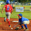 Stopped: Terre Haute North Little Leaguer Travis Adams scoops up a groundball as Wisconsin baserunner Kyle Jones makes it safely to second base.