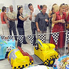Art lovers: A large group of art lovers gather to get a sneak-peak at the car art in the Education Center of the Swope Art Museum Friday evening.